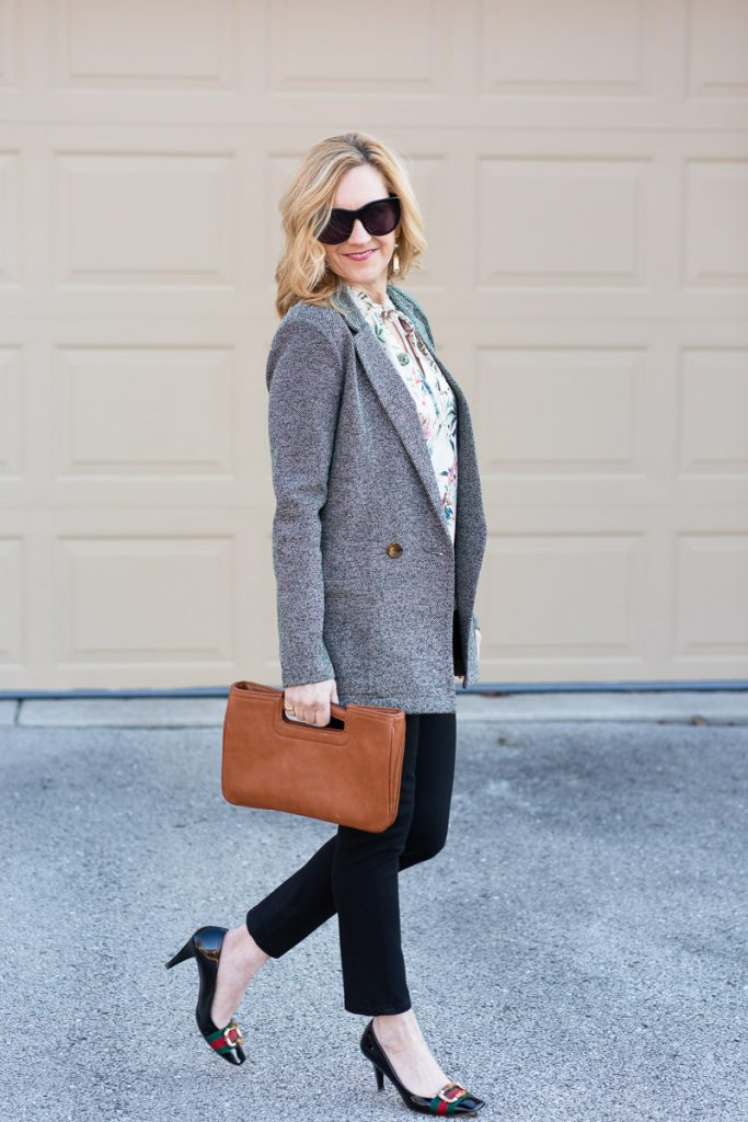 Styling a knit blazer with a floral tank for a chic spring workwear look.