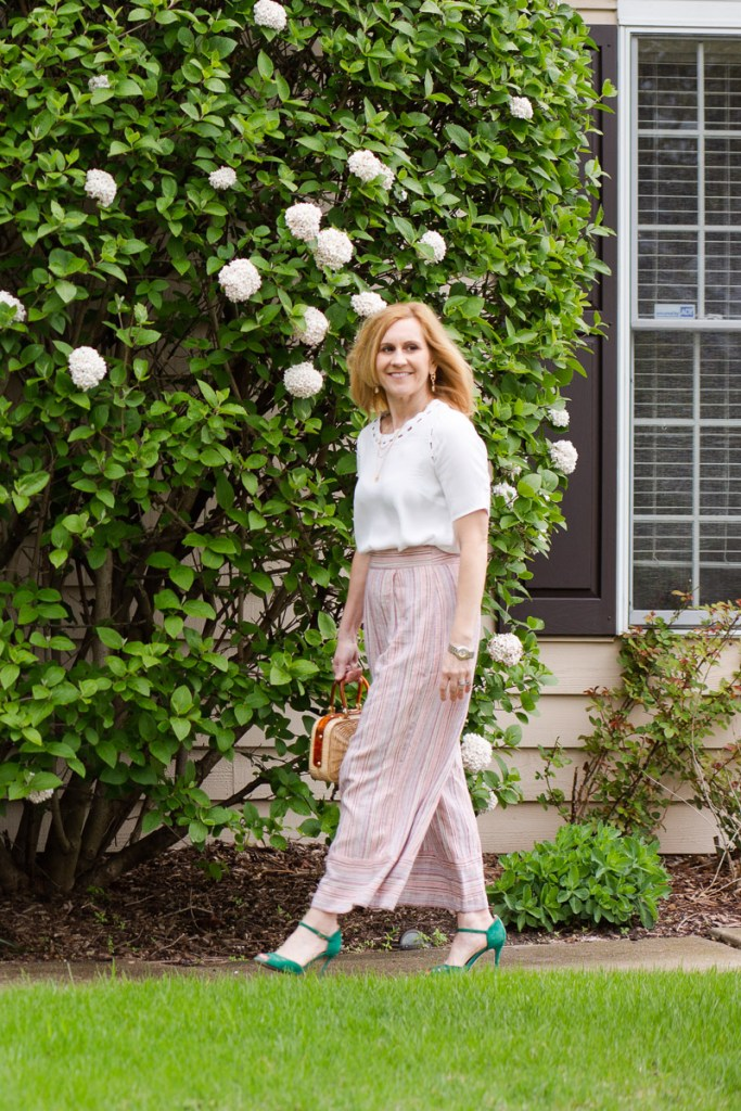 Dressing up wide leg dropped trousers with a white short sleeved blouse by Daniel Rainn.