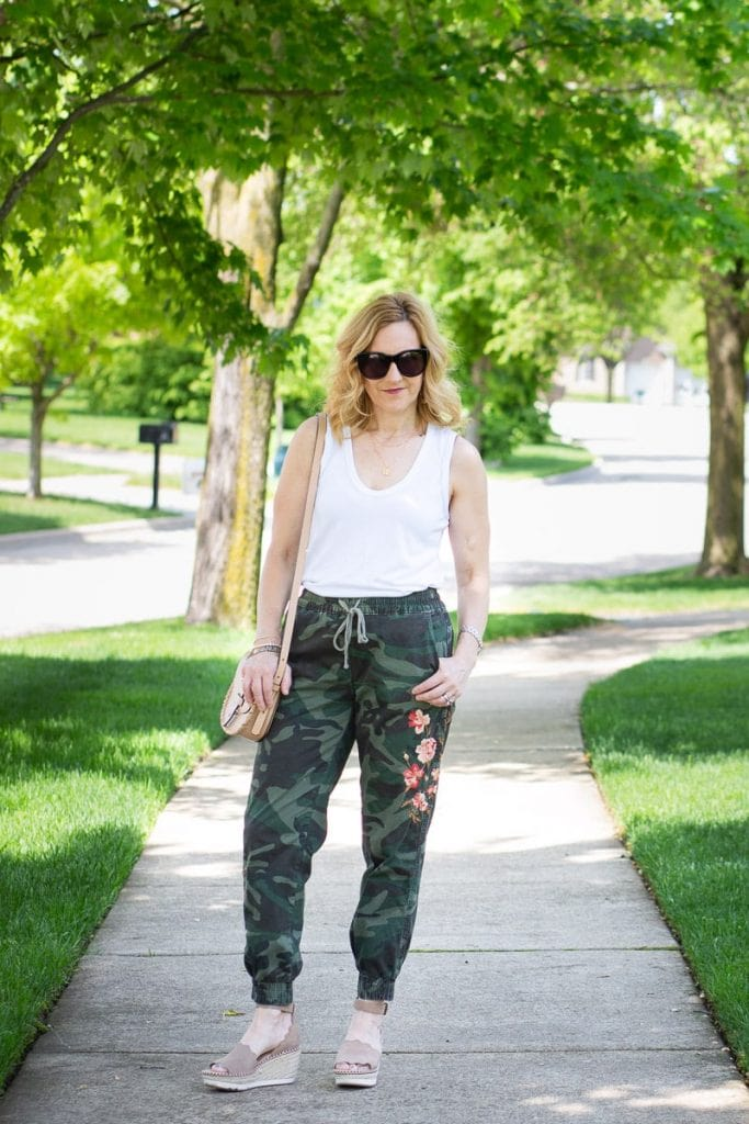 Styling comfy camo joggers with a white tank and wedges.