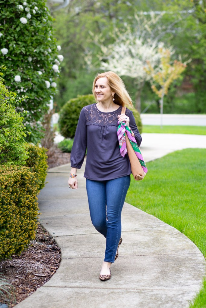 A charcoal lace blouse paired with skinny jeans and flats.