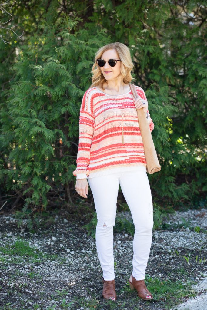 Pairing a spring sweater with white jeans and open toed sandals.