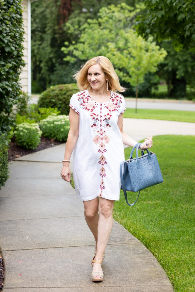 A white dress with boho chic embroidery.