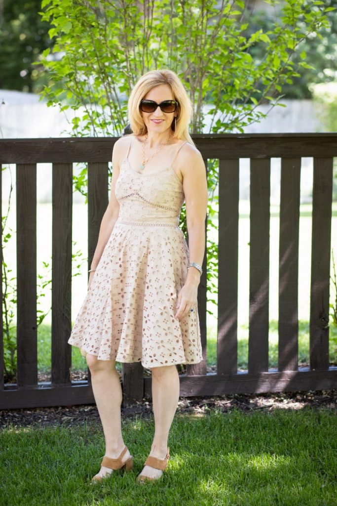 A tan eyelet dress that is perfect for summer.