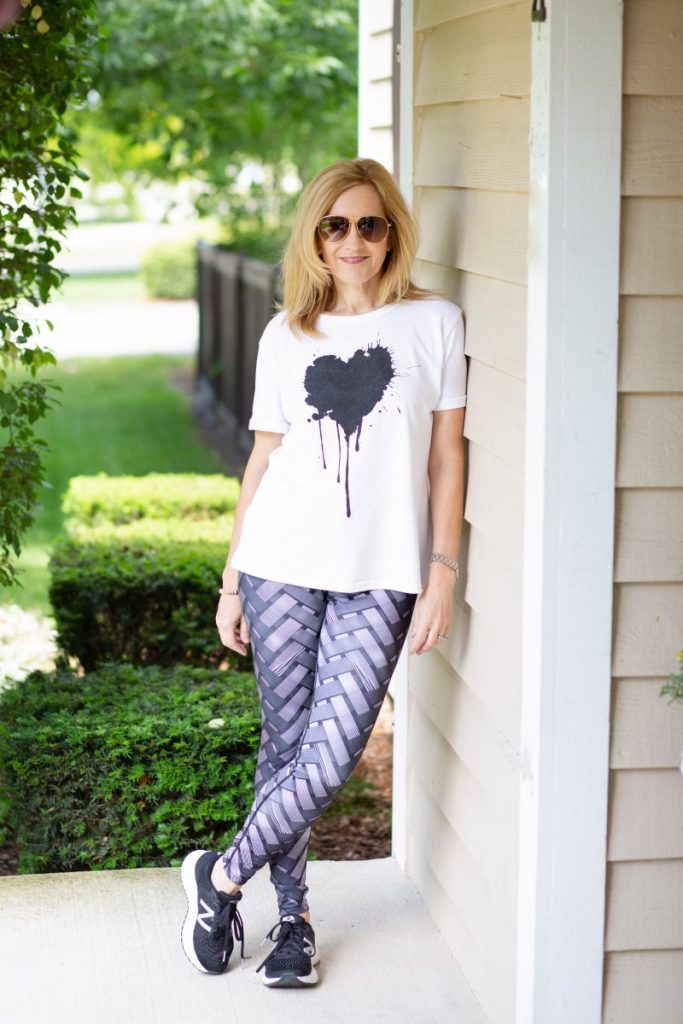 Black and white leggings paired with a heart graphic tee.