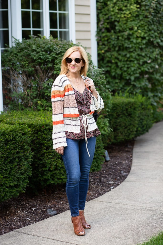 Mixing stripes and a dark floral print in a chic fall look.