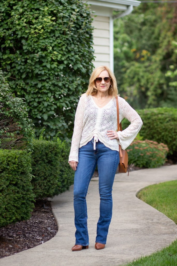 A casual boho chic cardigan paired with bootcut jeans and booties.