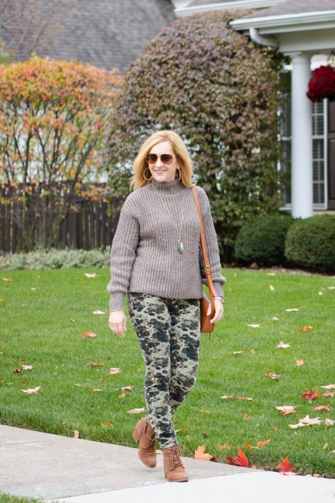 Pairing a chunky sweater with camo corduroy skinnies.