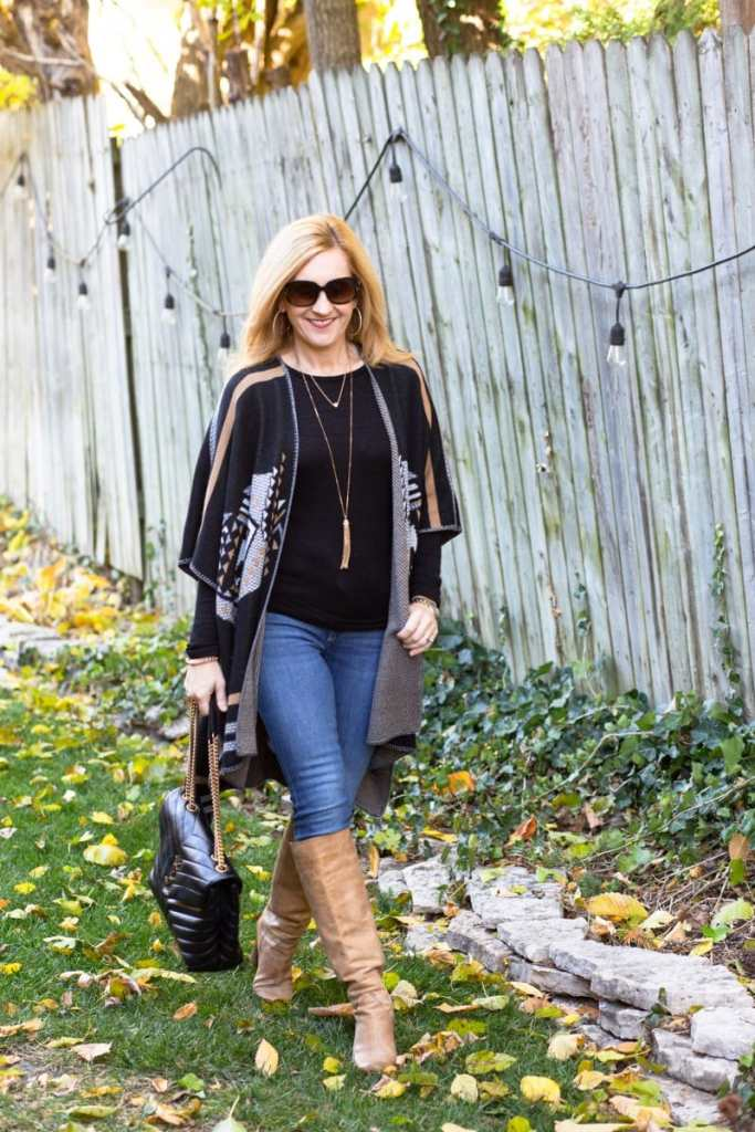 A fall look featuring an open poncho sweater by Driftwood with skinny jeans and tan knee boots.