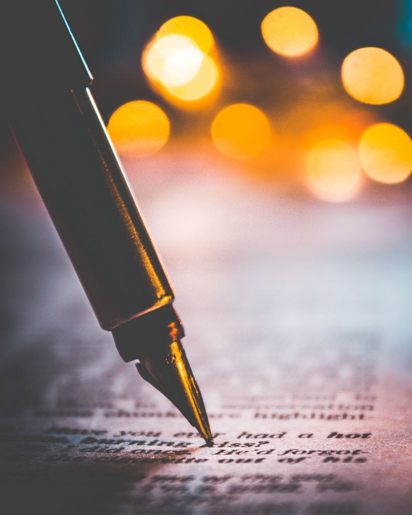 Flash fiction editing. Fountain pen and manuscript. Photo by Himesh Kumar Behera on Unsplash.
