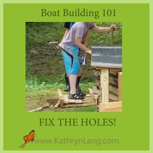 working on a boat - fixing the leak