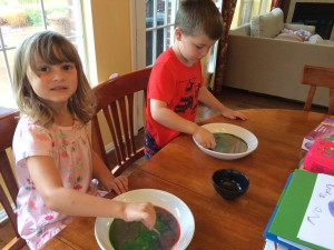 Our attempt at milk painting - may not be as pretty as the pictures on Pinterest, but they had fun!