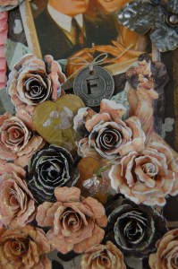Acrylic Paint was added to the petals of the rolled roses. Two hearts, embossed with UTEE containemica chips.