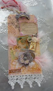 Jumbo Tag using images from  Le Romantique, Staples Flowers, Ornate Drawer pulls, feathers, tulle, stamping  dry embossing and gesso.