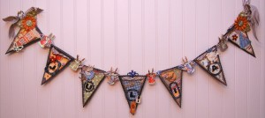Sweet vintage banner created using Playtimes Past, chipboard and fussy cutting.