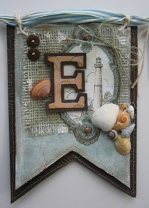 The letters were cut from designer paper, backed with brown cardstock and treated with glossy accents.