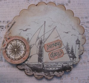 Here's the card out of the box.  I added the word fragments to the sails and created the compass tag using an old clothing tag and the images from the cut apart page in the Balmy Breeze collection.