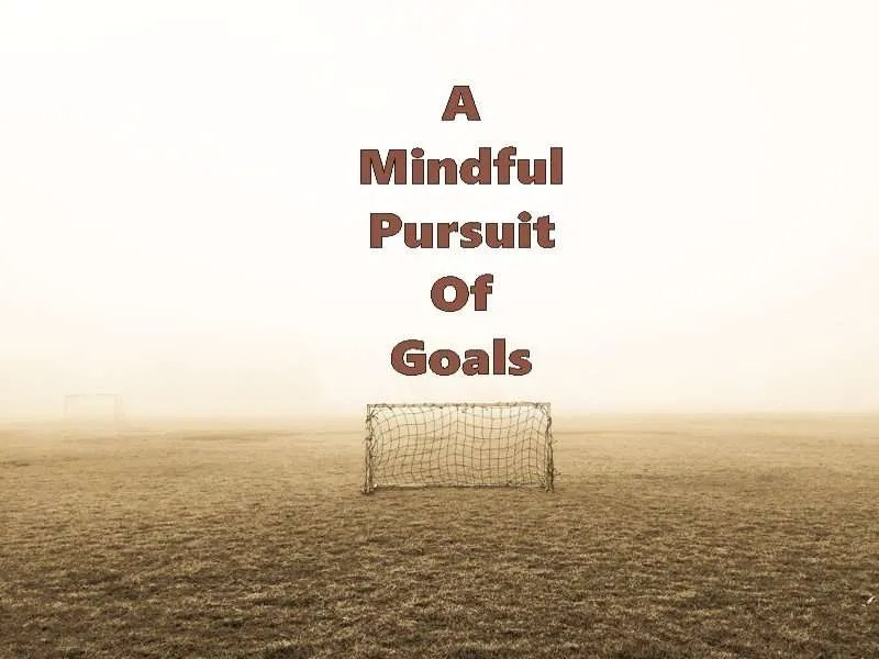 Empty field with a soccer goal and the title A Mindful Pursuit of Goals.