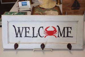 Welcome Sign with Hooks and Red Crab