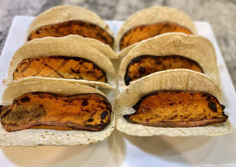 Grilled sweet potatoes inside taco shells