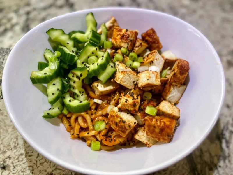 spicy cucumber salad in a tofu bowl