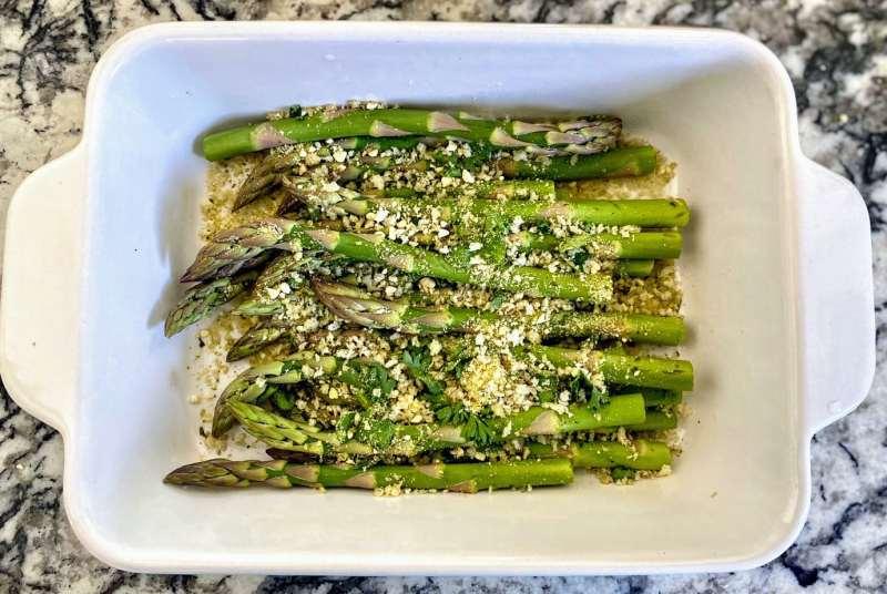 Preparing asparagus with parmesan