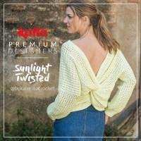 Maglione con il dietro ritorto e traforato disegnato da @bykaterinacrochet per i Premium Designers