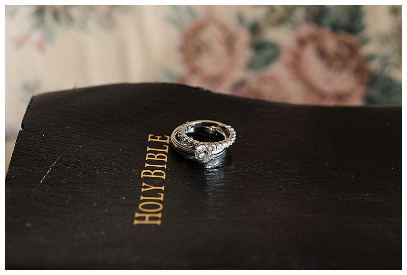wedding detail photo of bible and rings
