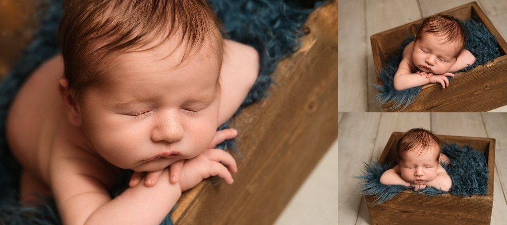newborn session baby boy in wooden crate with blue blanket. Macomb Newborn Photographer