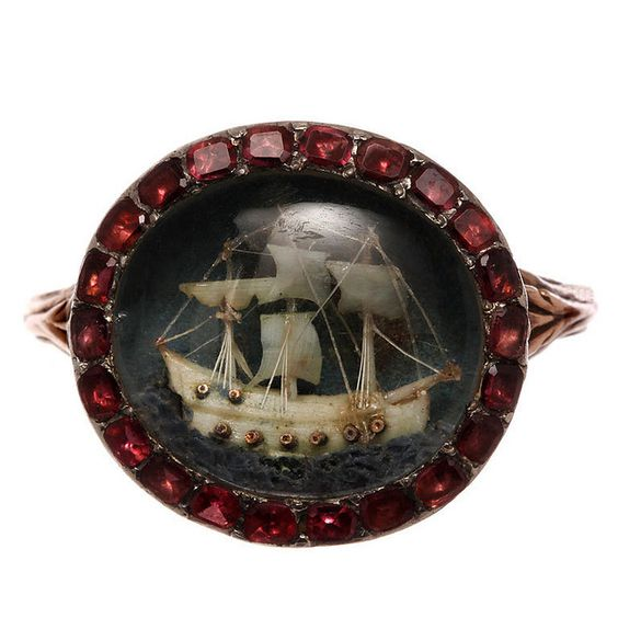 Georgian Period ring with ivory boat under rock crystal w/garnet surround