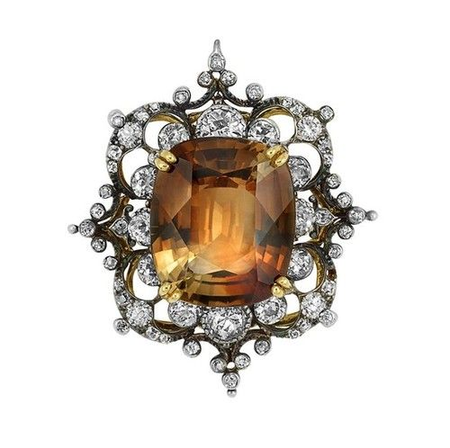Victorian silver, gold, topaz and diamond brooch centering one cushion-shaped topaz.