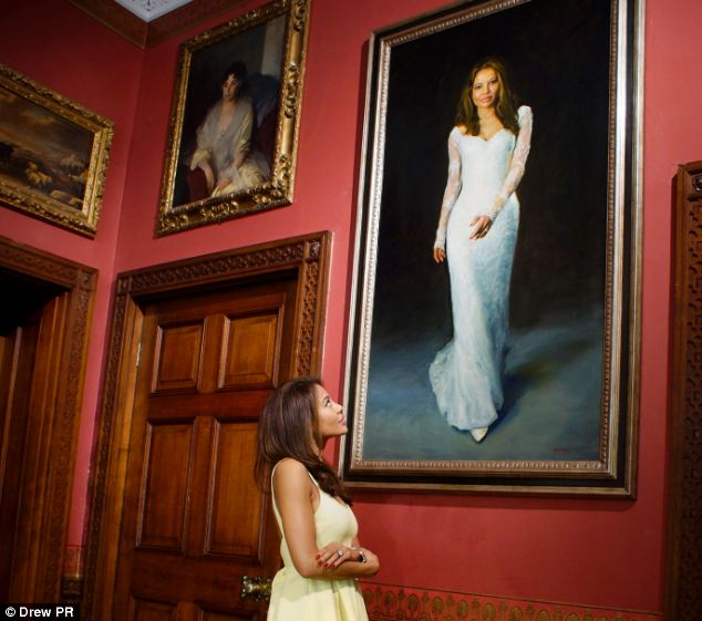 Emma Thynn in front of her wedding portrait