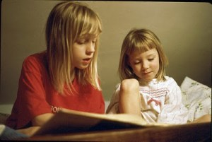 That's me on the left, reading to my little sister, Kylene, on the right.