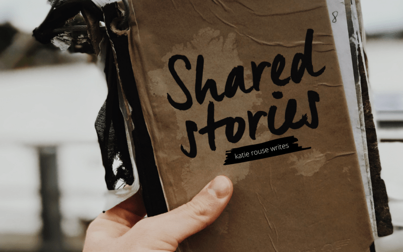 hand holding journals of shared stories up | katie shares her Covid-19 story