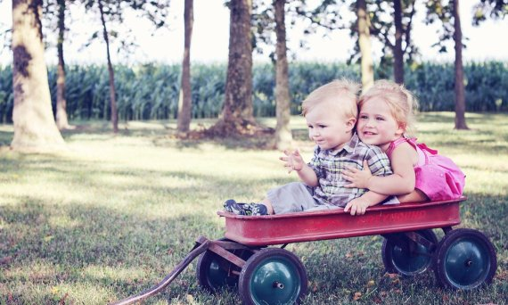 2 toddlers in a wagon