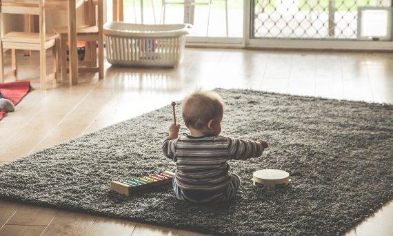 Toddler playing music