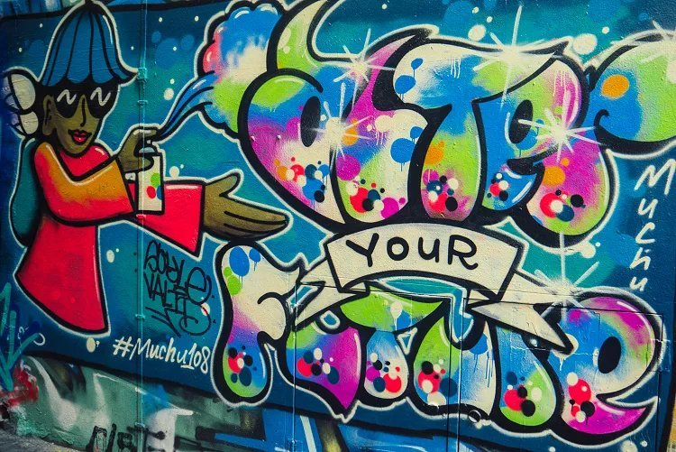 """Image of brightly coloured character with spray can spelling """"after your future"""" street art in Melbourne"""