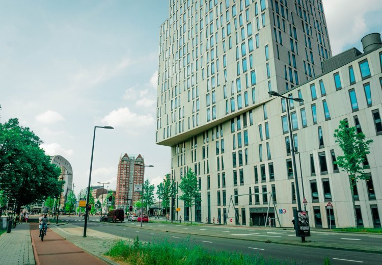 Image of street in Rotterdam with building stacked on top of one another hanging over the edge