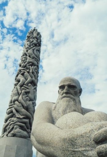 Image of old man sculpture and monolith in Vigeland Sculpture Park Oslo