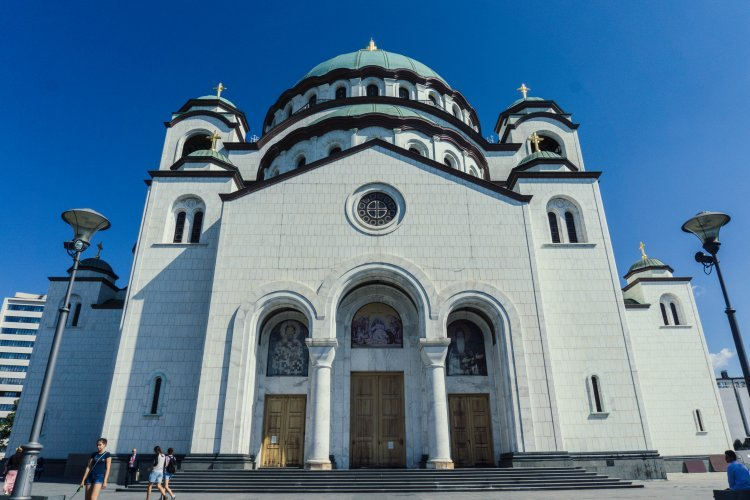 White marble exterior with green dome roof of large orthodox Catholic church of Saint Sava in Belgrade, Serbia