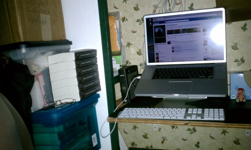 Port side of desk with cubbies and the file pile.