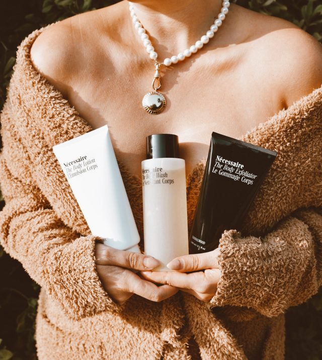 San Francisco fashion and lifestyle blogger KatWalkSF hold the Nécessaire The Body Essentials Kit in her SKIMS robe