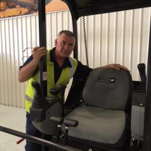 To show a canvas seat cover for a Caterpillar Skid Steer Loader