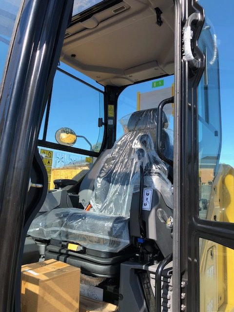 To show a canvas seat cover for a Caterpillar Excavator