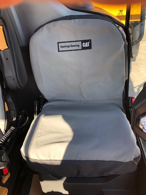 To show a canvas seat cover for a Caterpillar Articulated Trucks