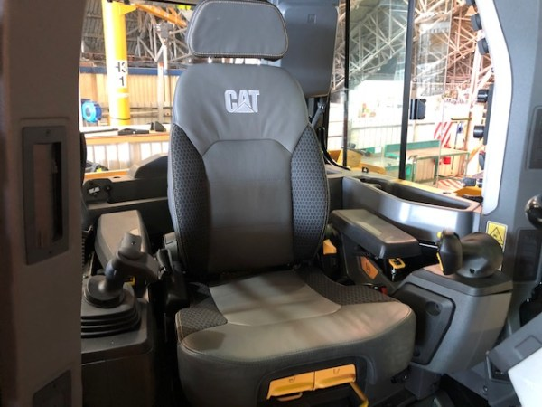 To show a canvas seat cover for a Caterpillar Dozer