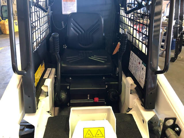Canvas seat cover for a Bobcat Skid Steer