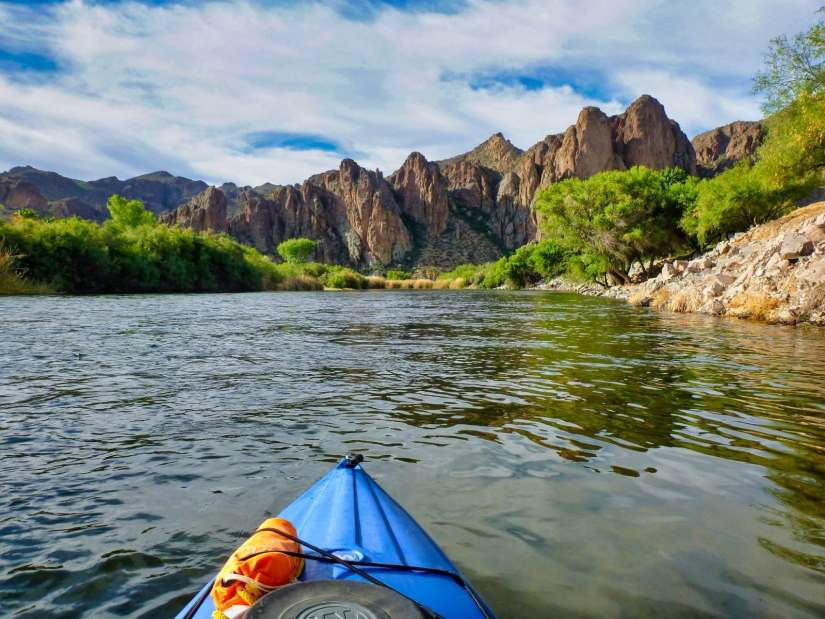 View of Goldfield Mountains and Salt River from a blue kayak