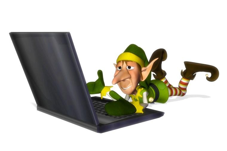 santa helper cartoon laptop laying down