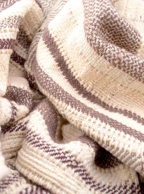 Throw blanketcreated with brownand taupe angora wood,pinky beigesilk floss,silk, cashmere, country wool,ecruwool,and beige cotton threads slipped into the plaid.  Technique:Throw blanket hand-woven in a traditional way on non-mechanical looms in the 7th arrondissement of Paris in France.  Finishes: Right edge. Double stitching.  Size: 145 x 180 cm.  Single piece / 1 copy only.