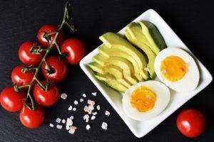 tomatoes, sliced avocado, boiled egg, pink salt